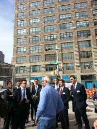 Photo: Mr. Jason Pizer (front) of Trinity Real Estate leads a Columbia Business School students on a tour of Hudson Square.