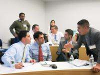 Photo: Students strategize at the Coming to Terms: Negotiating Real Estate Joint Ventures event.