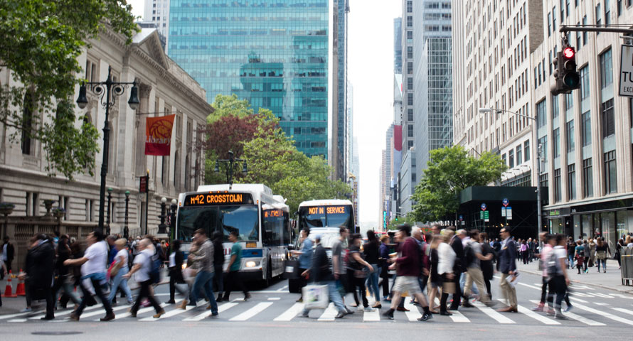 a crowded city street in Manhattan's midtown business district